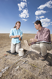 Ecologist David Augustine (left) and technician Reanna Moore collect forage samples from a black-tailed prairie dog colony in eastern Colorado in a study of grazing competition between prairie dogs and cattle: Click here for photo caption.