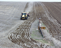 A research watershed near Pendleton, Oregon, shows the amount of residue left after October no-till seeding, with a glimpse of a traditionally tilled field without surface residue in the far right: Click here for photo caption.