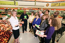 Jessica Kiel (left), registered dietitian and president-elect of the Maryland Dietetic Association, encourages shoppers to use USDA's ChooseMyPlate.gov interactive tools--which use USDA-ARS national nutrient data--to make better, healthier food choices: Click here for full photo caption.