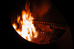 Photo: A boiler furnace with a fire fueled by biomass pellets. Link to photo information
