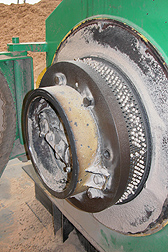 A die extrudes pellets at the pellet mill of Plainview Growers in Allamuchy, New Jersey, as a feedstock for heating greenhouses: Click here for photo caption.