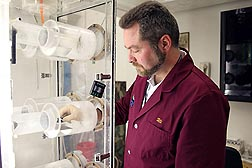 In Gainesville, Florida, ARS chemist Uli Bernier uses an olfactometer to evaluate the efficacy of a chemical to inhibit mosquitoes from being attracted to humans: Click here for photo caption.