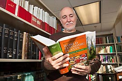 "At the ARS Germplasm Resources Information Network (GRIN) taxonomy botany library in Beltsville, Maryland, botanist John Wiersema reviews the new edition of ""World Economic Plants: A Standard Reference,"" which he coauthored: Click here for photo caption."