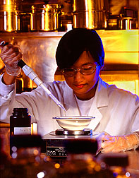ARS technician Janet Chan ads a precise amount of folate solution to a dish of applesauce.