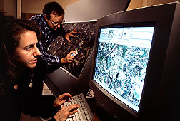 Sara Loechel, a remote sensing researcher, labels fields, woodlands, and streams on a computer. Click here for full photo caption.