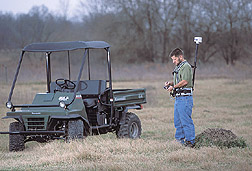 Technician uses a GPS unit to record the exact position of a fire ant mound: Click here for full photo caption.