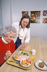 Chemist and study volunteer discuss the way barley was incorporated into meals: Click here for full photo caption.