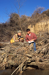 Hydraulic engineer and technician record the location and condition of a large woody debris structure: Click here for full photo caption.