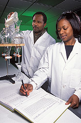 Chemist and technician process water samples: Click here for full photo caption.