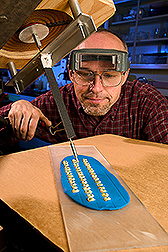 Technician injects virus into corn kernels: Click here for full photo caption.