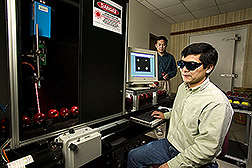 Renfu Lu and Yankun Peng test laser-based multispectral imaging prototype for real-time detection of apple firmness and sugar content. Link to photo information