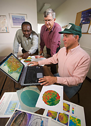 Colorado State University horticulturist, extension agent, and soil scientist discuss use of the NLEAP computer model and GIS: Click here for full photo caption.
