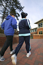 Photo: A man and a woman outdoors for a vigorous stroll. Link to photo information