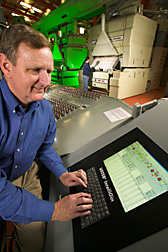 Agricultural engineer inputs control data into a computerized process control system: Click here for full photo caption.