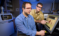 With inductively coupled plasma emission spectroscopy, technician (left) and horticulturist can detect and measure many elements in plant tissue, soil, and solution samples at concentration levels in the parts per billion: Click here for full photo caption.