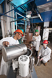 In the new sugar-processing pilot plant at SRRC, chemist (center) works with chemical engineer (right) and physical science technician (left) to process sugarcane: Click her for full photo caption.