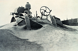 Wind erosion in the Dust Bowl lasted for years in the 1930s, moving dramatic amounts of valuable soil--enough to practically bury this farm machine: Click here for photo caption.