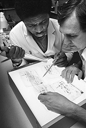 Researchers in the 1980s examine protein profiles of soybean cultivars: Click here for full photo caption.
