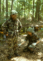 In 1984, ARS technicians Kenneth Posey (left) and Dick Godwin conduct a Florida field test of mosquito repellents on skin and in military uniforms: Click here for photo caption.