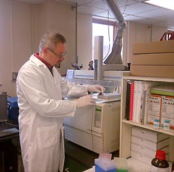 Physiologist Matthew Picklo performs fatty acid analysis of a sample of human blood plasma to determine the effects of salmon consumption: Click here for full photo caption.