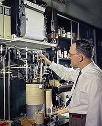 WRRC scientist Ron Buttery, shown here adjusting a gas chromatography apparatus in 1959, was the first to identify the compound primarily responsible for the flavor of aromatic rice: Click here for photo caption.