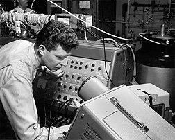 WRRC scientist Bill McFadden operates the mass spectrometer portion of the gas chromatography/mass spectroscopy apparatus first reported at WRRC. (1963): Click here for photo caption.