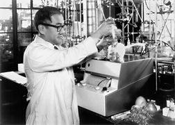 WRRC scientist Roy Teranishi samples the headspace over fresh grapes just before injecting a sample into a gas chromatograph. (1963): Click here for photo caption.