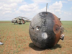 In Kazakhstan, not far from the Russian border, the Foton-M2 capsule is back on Earth after more than 2 weeks in space.