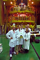 Project coordinator Maria Teresa Giardi and fellow engineers hold the experiment materials before they are loaded into the capsule: Click here for photo caption.