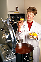 Nutritionist Joanne Holden looks over tomato products prepared for a study of carotenoids. Click here for full photo caption.