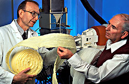 George Fanta (left) and Don Fisk, president of Uni-Star, Inc., examine foam packing material extruded from biodegradable cornstarch.