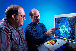 Electrical engineer and meteorologist examine clear-air imagery from a NEXRAD Doppler weather radar. Click here for full photo caption.
