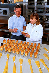 The quality of test bread loaves made with a blend of durum and spring wheats is evaluated. Click here for full photo caption.