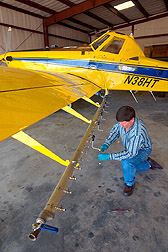 Photo: Clint Hoffman selects the correct nozzles and locations on a spray boom. Link to photo information