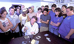 Photo: Students watch as APHIS veterinarian John Duncan performs a test for scrapie susceptibility. Link to photo information