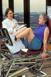 Woman using exercise equipment: Click here for full photo caption.
