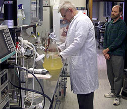 Microbiologist observes Russian scientist harvesting bacteriocins: Click here for full photo caption.