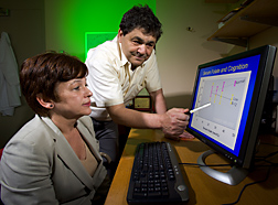 Photo: Martha Morris and Jacob Selhub examine computer display of data. Link to photo information