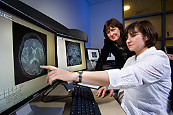 Nutritional epidemiologist (left) and neuropsychologist examine MRI (magnetic resonance imaging) brain scans to determine size and area of damage that may affect cognitive functions: Click here for full photo caption.