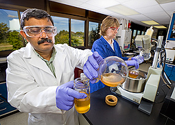 Former ARS chemist (left) and technician purify glycerol, a biodiesel coproduct that can be used to produce value-added materials: Click here for full photo caption.