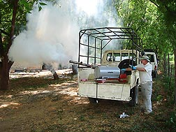 In Marigat, Kenya, Kenneth Linthicum, the director of ARS's Center for Medical, Agricultural, and Veterinary Entomology in Gainesville, Florida, calibrates a thermal fogger in preparation for experimental applications of aerosol pesticides to control sand flies: Click here for full photo caption.