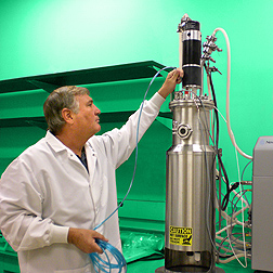 Plant pathologist Doug Boyette prepares a fermenter for growing fungus: Click here for full photo caption.