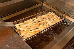 Photo: French fries in a commercial deep fat fryer. Link to photo information