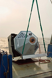 A tsunami buoy is launched into the ocean from a National Oceanic and Atmospheric Administration ship: Click here for photo caption.