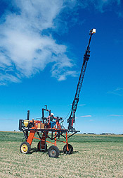 Engineering technician operates a high-clearance tractor to collect multispectral reflectance data. Click here for full photo caption.