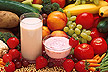 A variety of fruits, vegetables, milk and  yogurt.