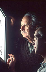 Scientists examine an image from a viroid-screening test: Click here for full photo caption.