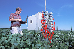 Engineer programs carbon dioxide and ozone level controls: Click here for full photo caption.