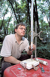 Hydrologist collects groundwater: Click here for full photo caption.