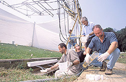 Photo: Scientists work together to conduct a rainfall-simulation test to measure bacteria levels in runoff water. Link to photo information